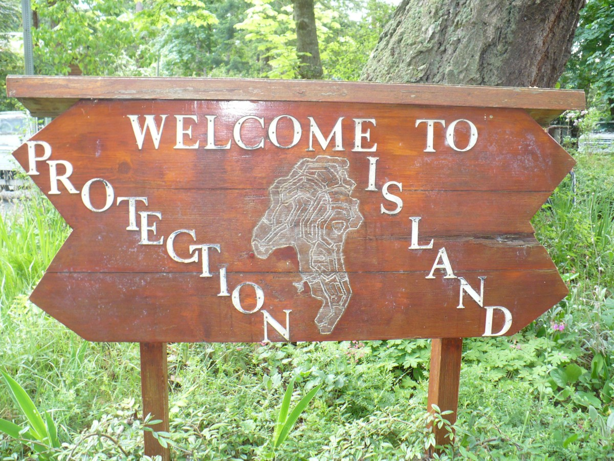 Photo of a wooden sign stating Welcome to Protection Island