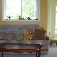 Photo of the couch, coffee table, and part of the play area at Ahoy Guesthouse, Protection Island