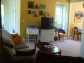 Photo of living room at Ahoy Guesthouse, Protection Island, including couch, coffee table, TV, DVD/VHS player and more