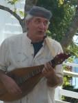 photo of Rick Scott playing dulcimer