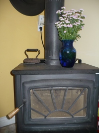 Woodstove provides cozy heat in wintertime.