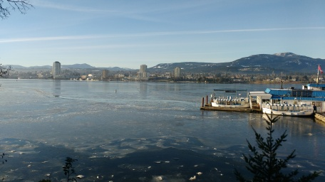 view from Protection Island to Nanaimo, with Dinghy Dock pub, showing icy waters far out.